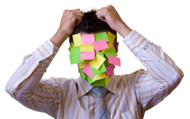 Confused man with post it notes